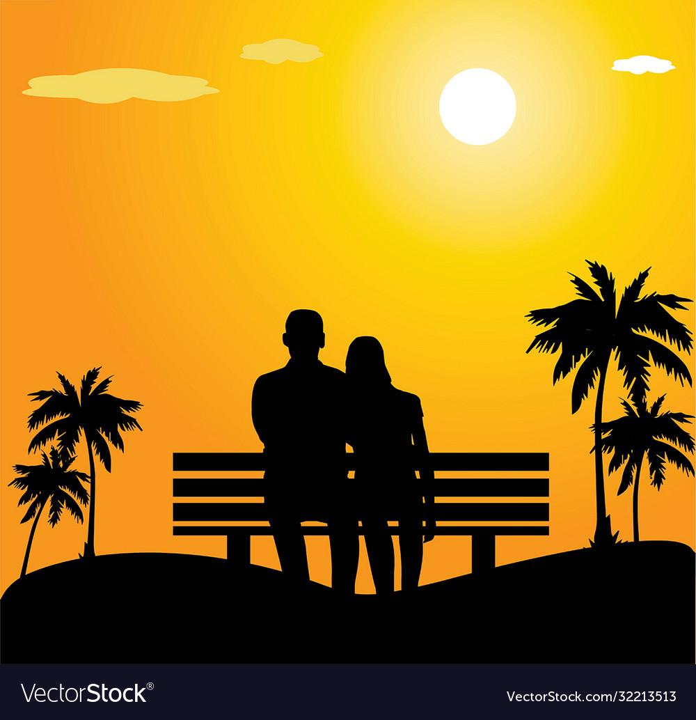 Sunset couple sitting on bench silhoutes