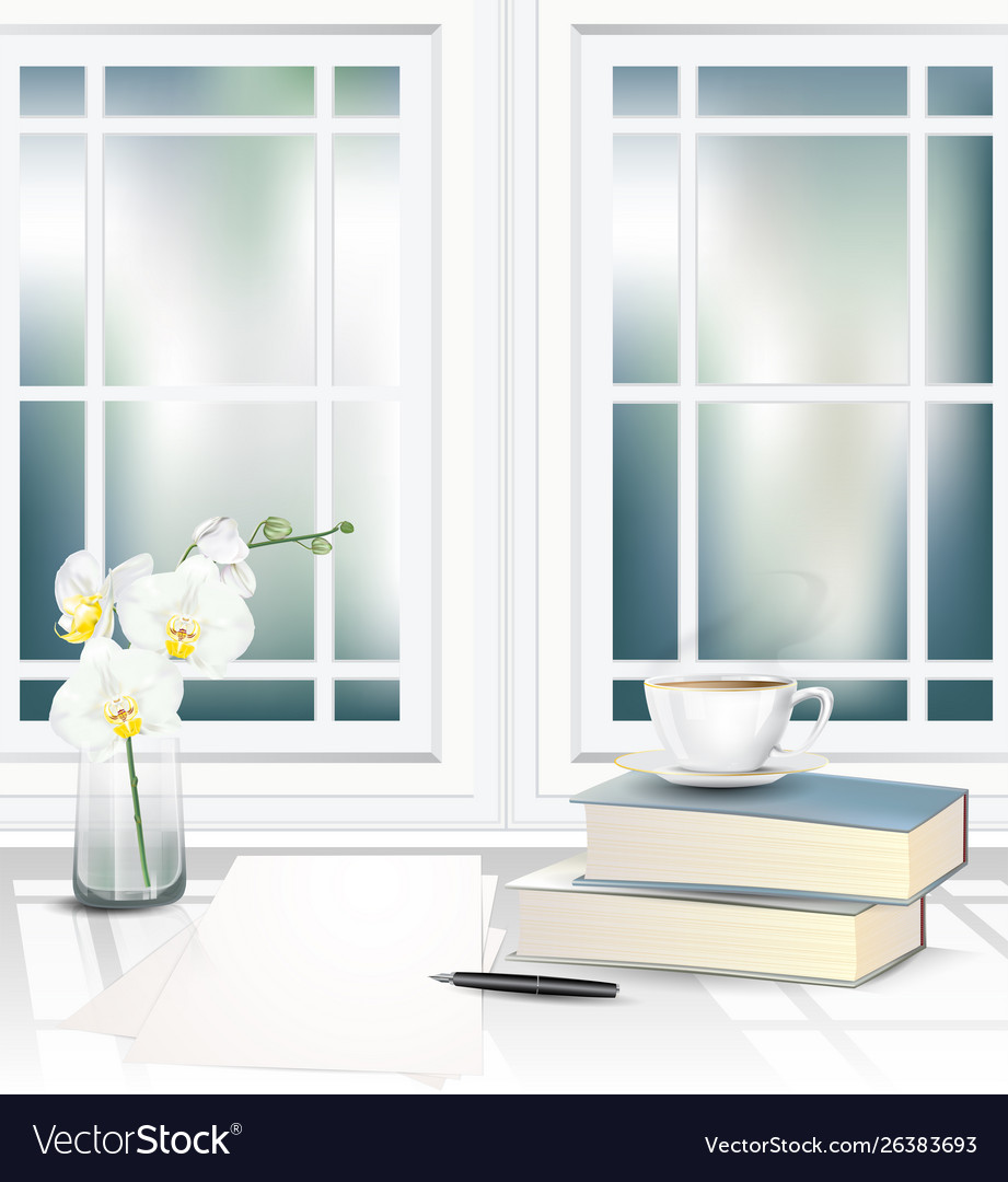 Tea cup and books on table beside window