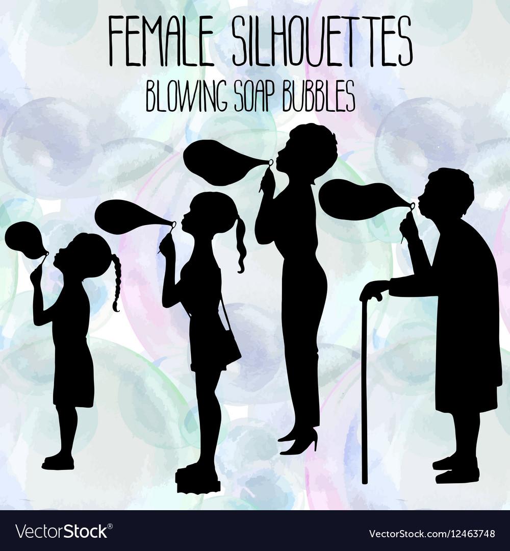 Female silhouettes blowing soap bubbles