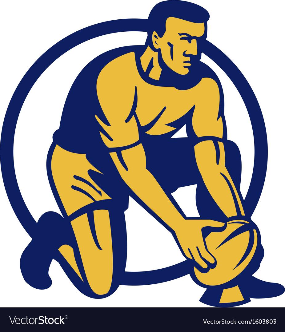 Rugby player kneeling preparing a goal kick