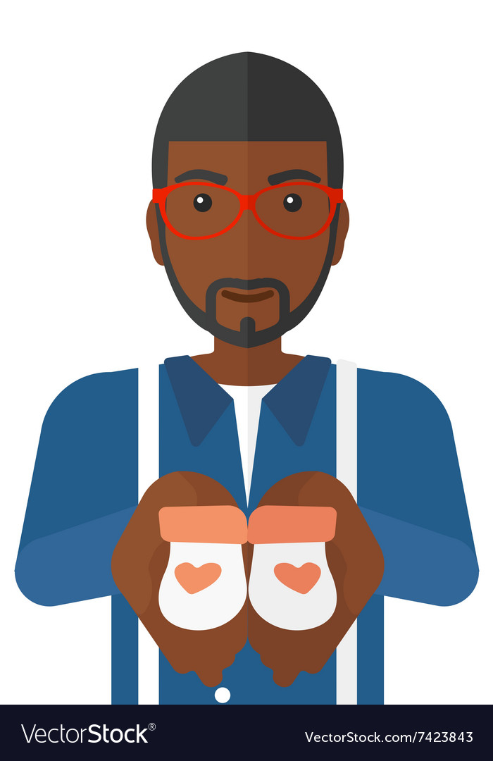 Man holding baby booties