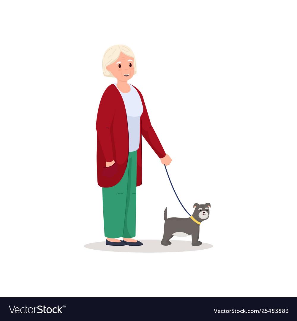 Cute smiling senior woman walking with cute dog