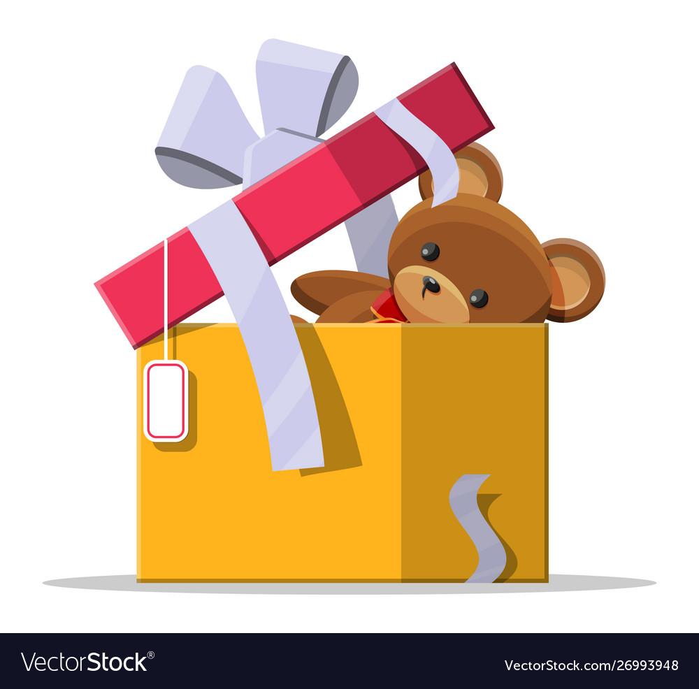 Teddy bear inside gift box