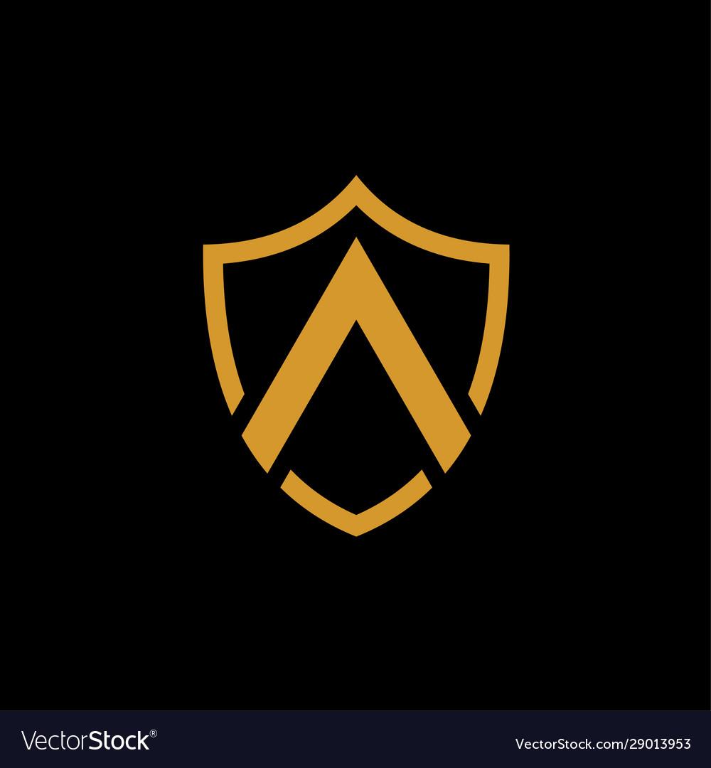 A shield shape gold logo on black background