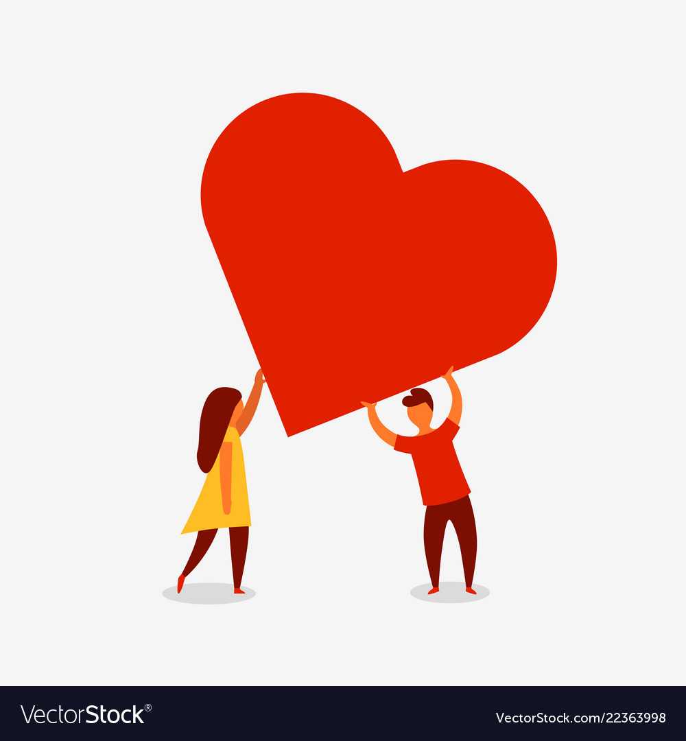 Man and woman holding big red heart valentine day