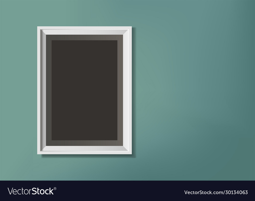 Photo frame on green wall