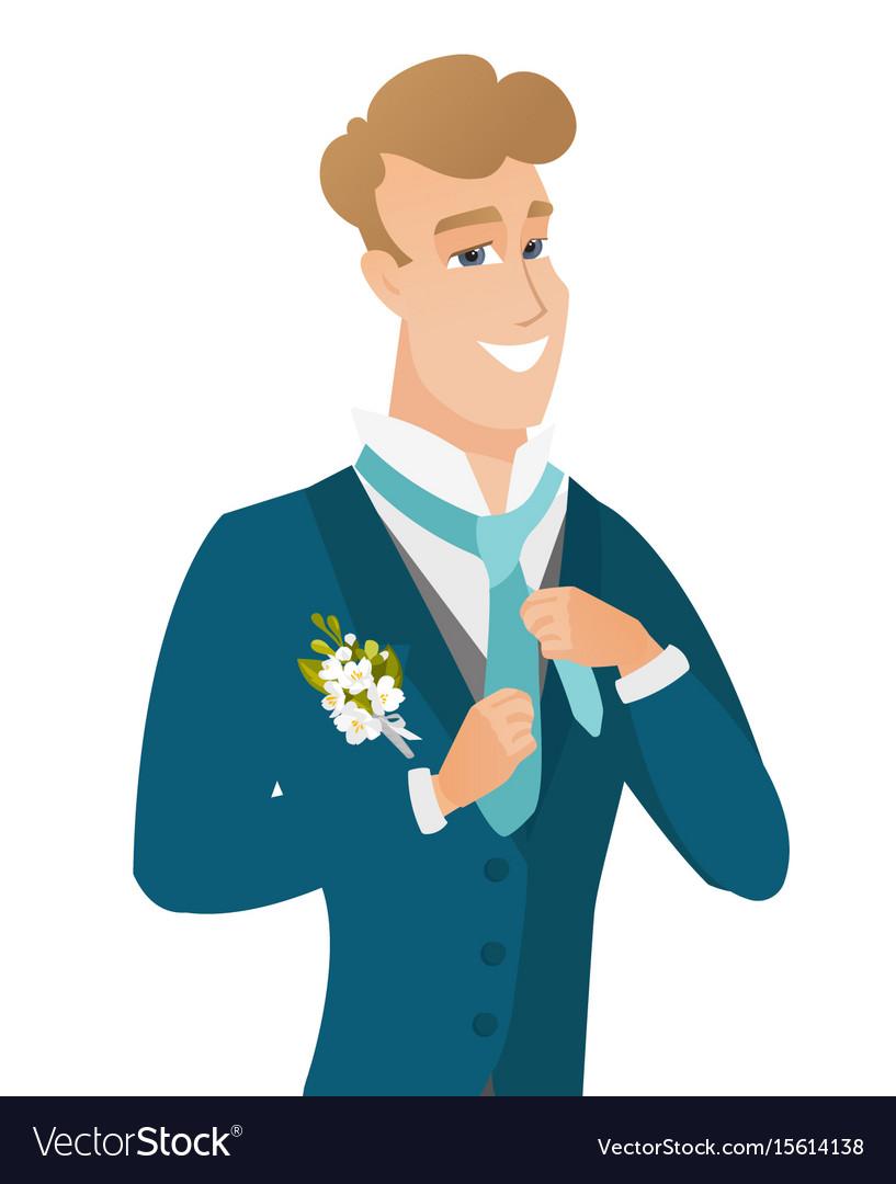 Young caucasian cheerful groom adjusting tie