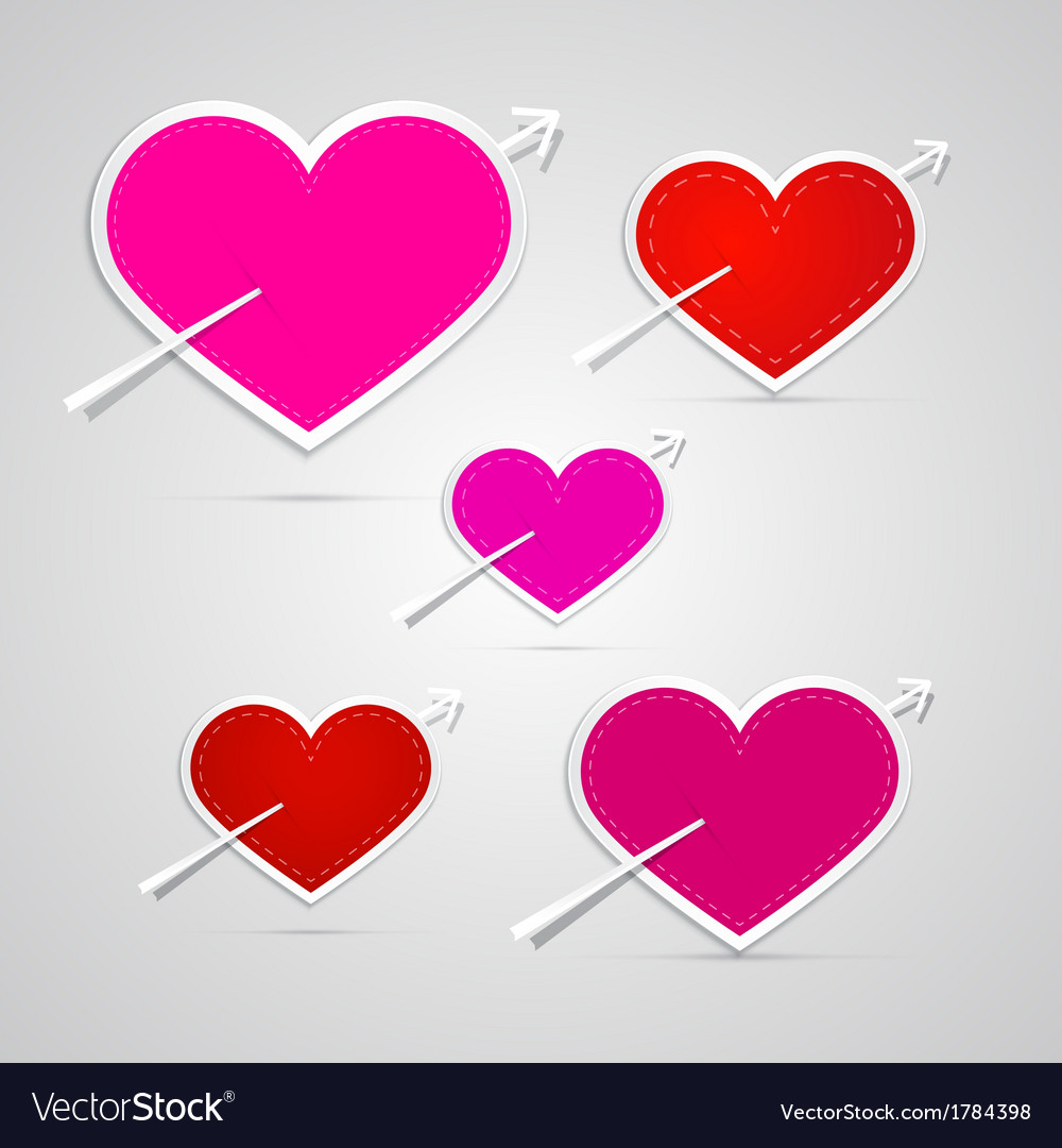Paper red pink hearts pierced with arrows