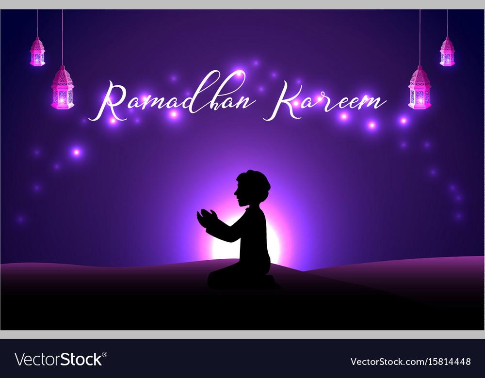 Muslim man praying silhouette at the desert night