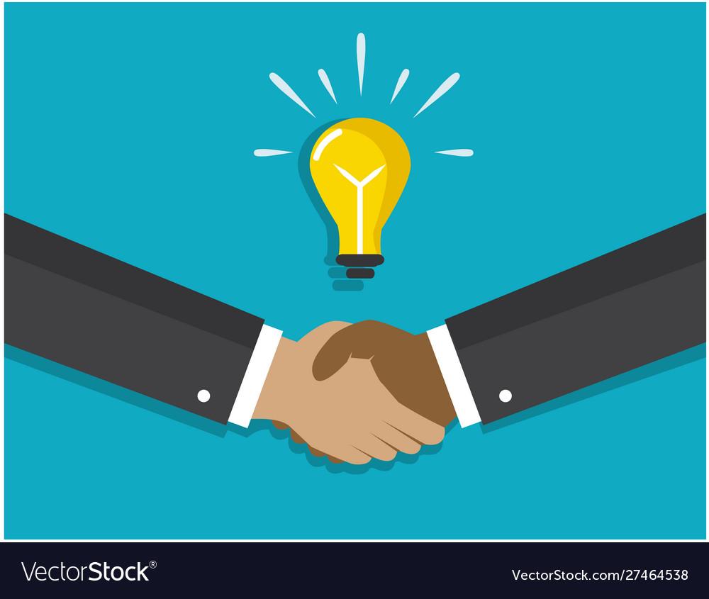 A handshake and a light bulb symbolizes idea