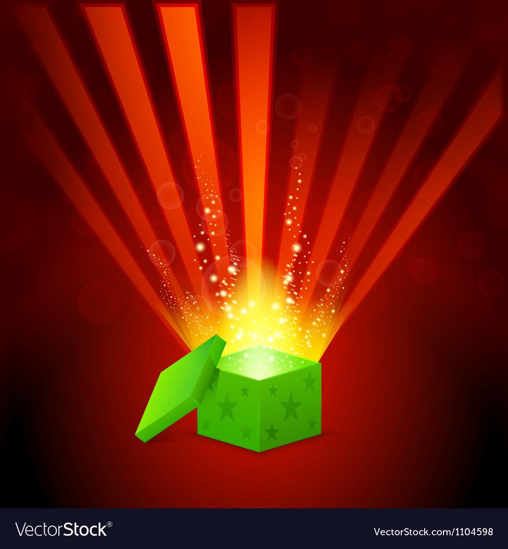 Beautiful magic light shining from a green gift vector image