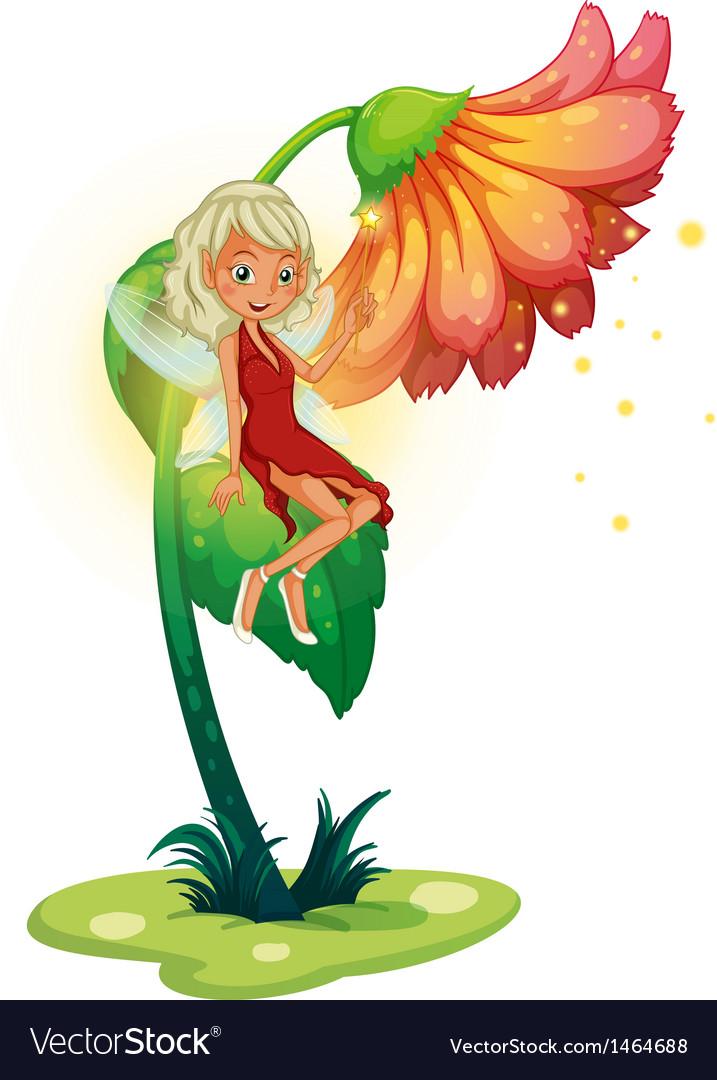 A fairy floating near the giant flower