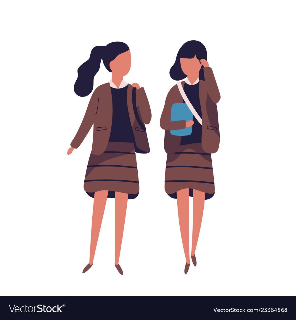 Pair of girls dressed in school uniform female