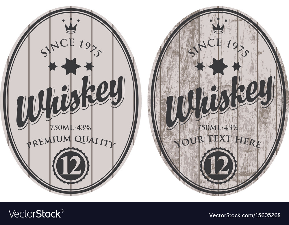Two oval labels for whiskey on wooden background