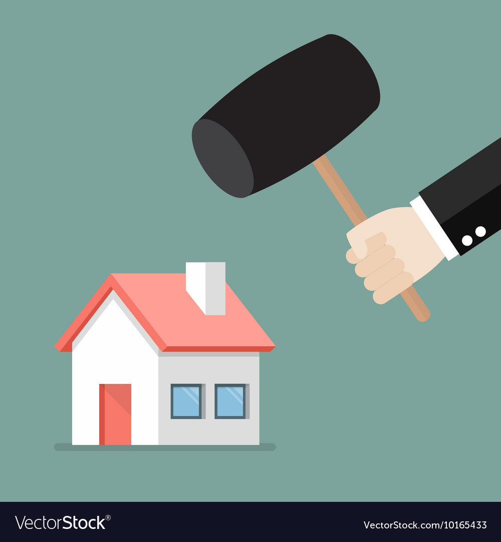 Business man handle a hammer to destroy a house