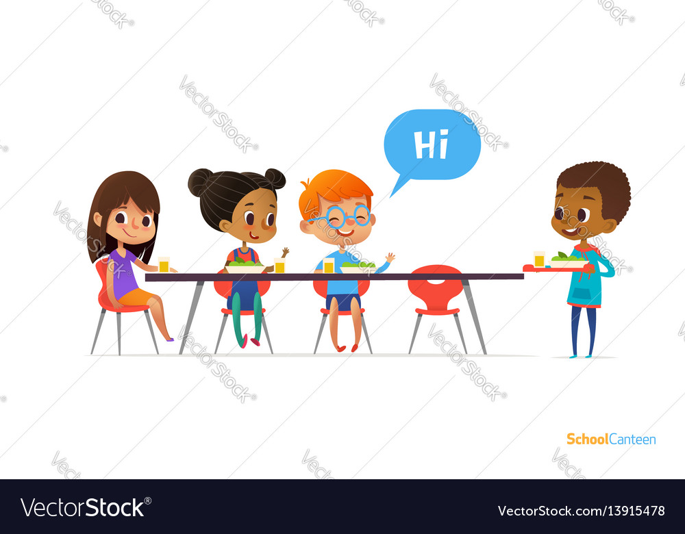 Multiracial kids sitting at table in school