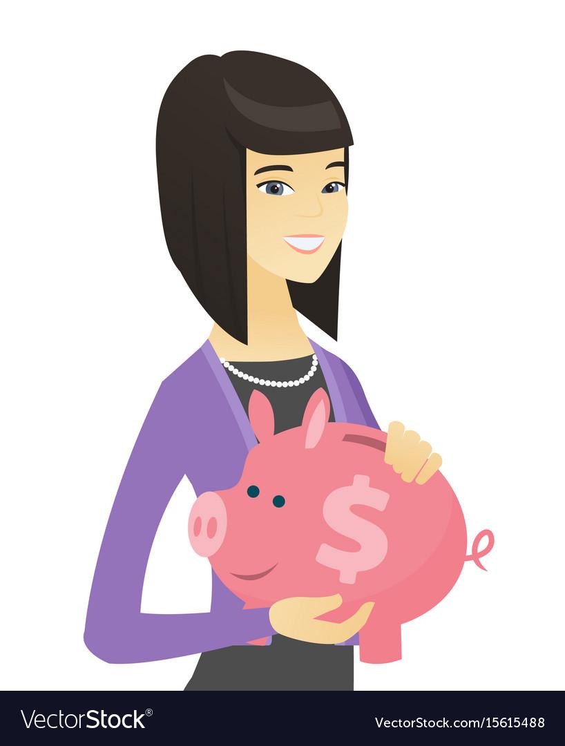 Asian business woman holding a piggy bank