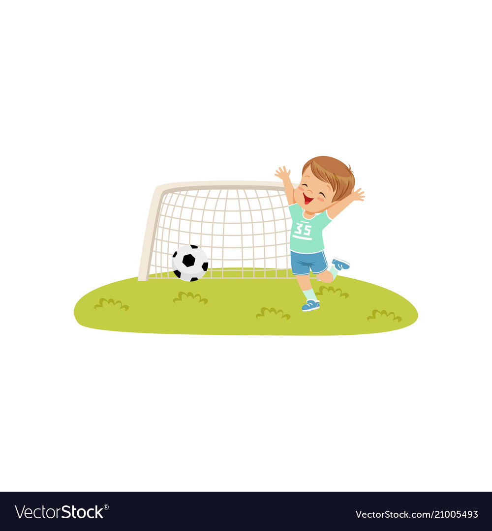 Cute smiing boy threw the ball into the goal kids