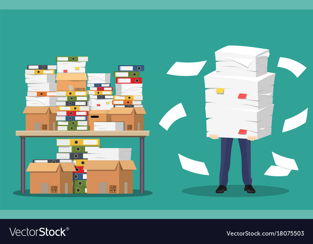 Businessman holds pile of office papers and
