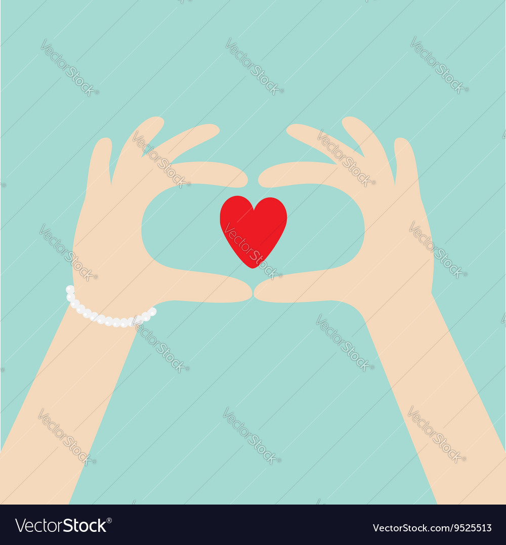 Woman hands in the form of heart Female holding