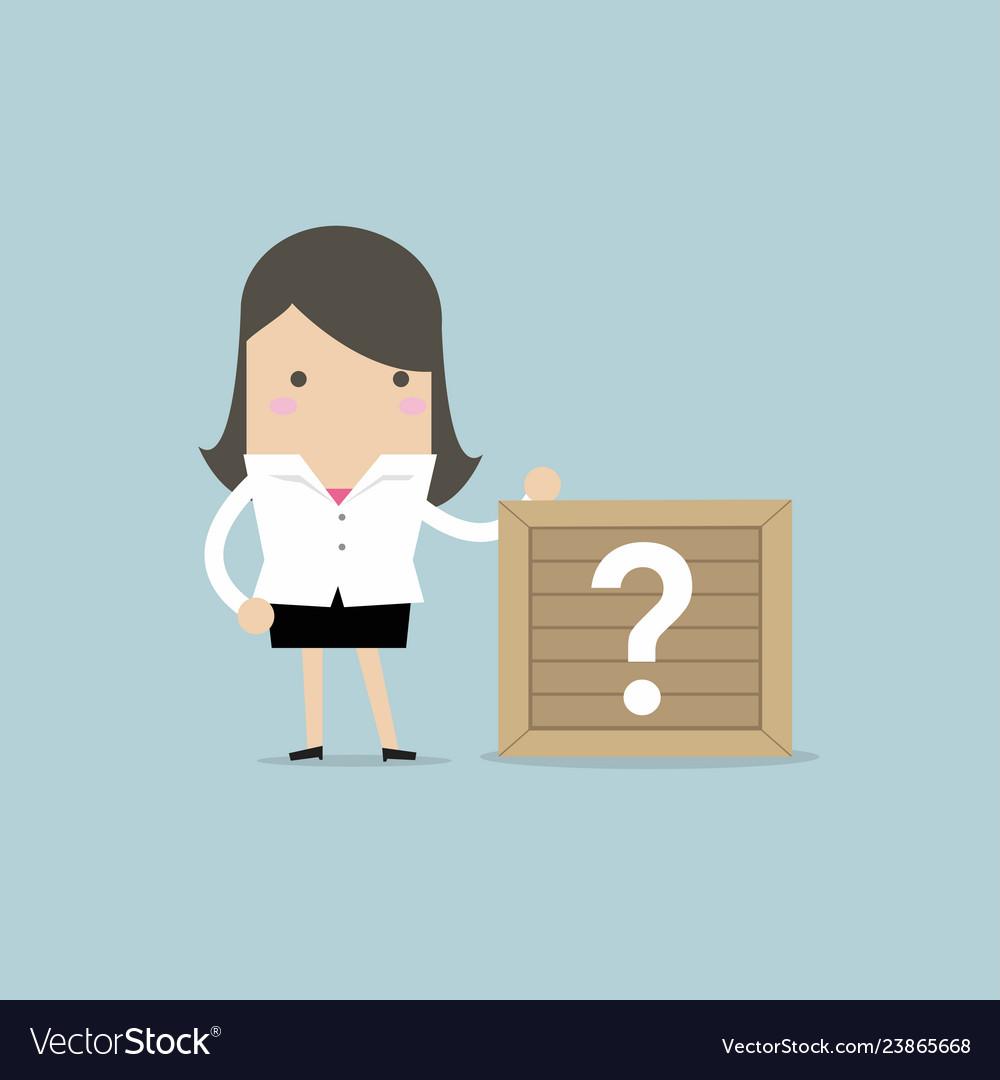 Businesswoman standing beside unknown box