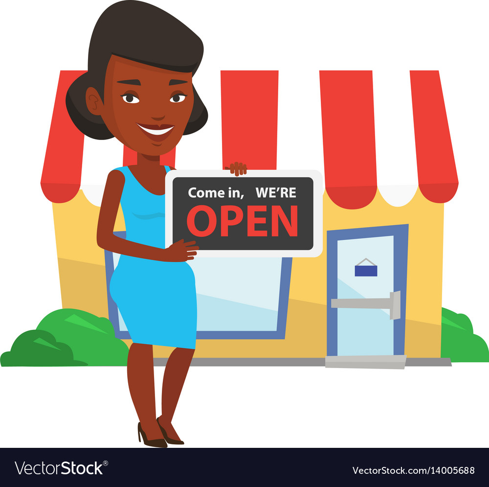 African shop owner holding open signboard