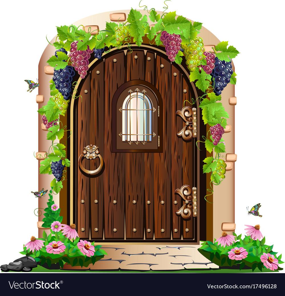 Old wooden door in the garden Royalty Free Vector Image