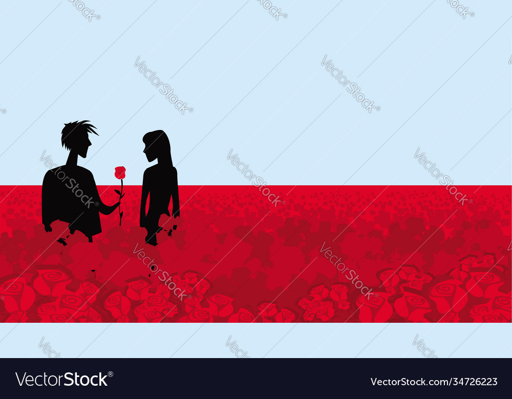 Boy and girl on a field red roses