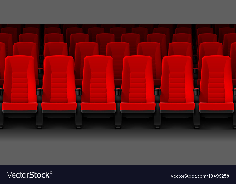 Movie theater with rows of red empty chairs