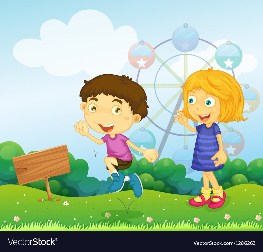 A boy and a girl playing near an empty signboard