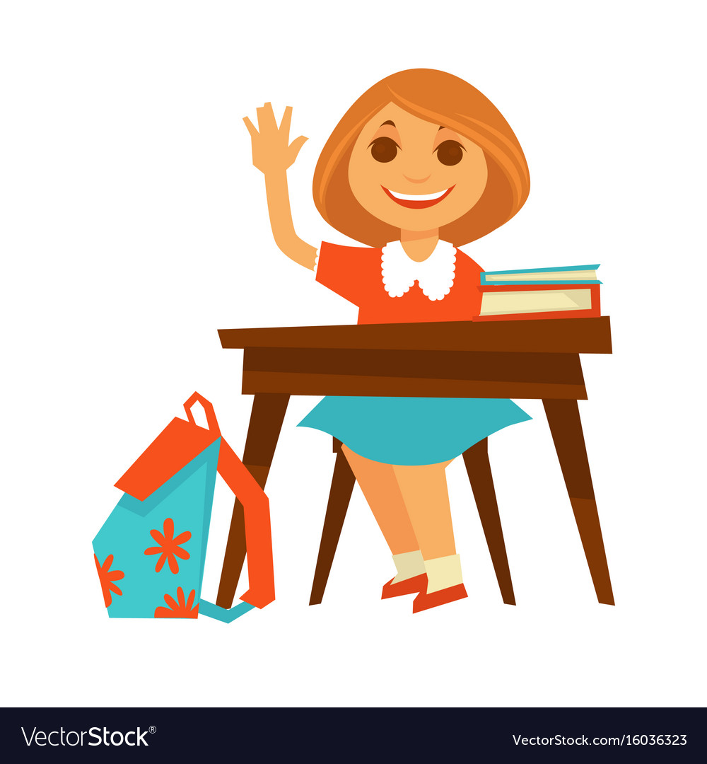 Cheerful little girl sits at desk in school