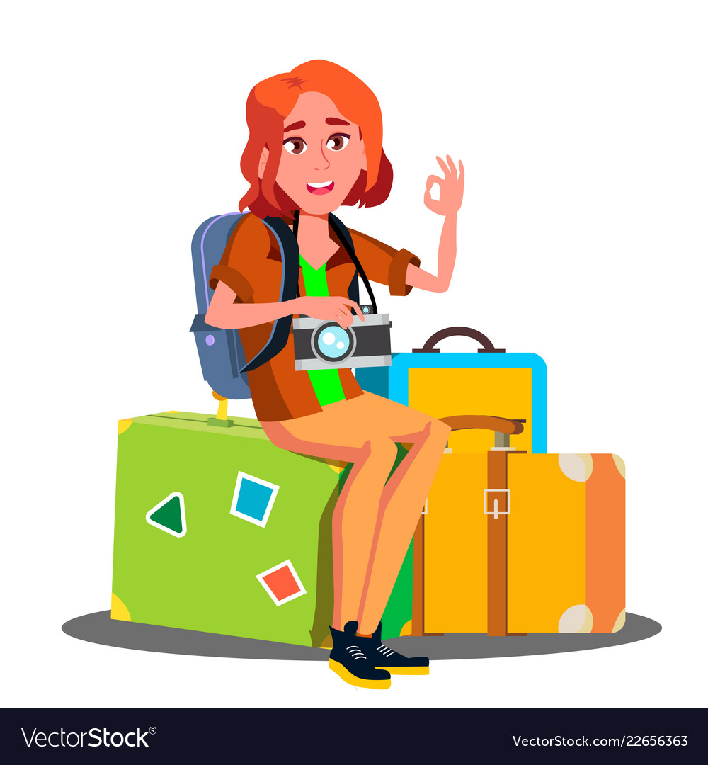 Happy girl sitting on pile of suitcases ready to