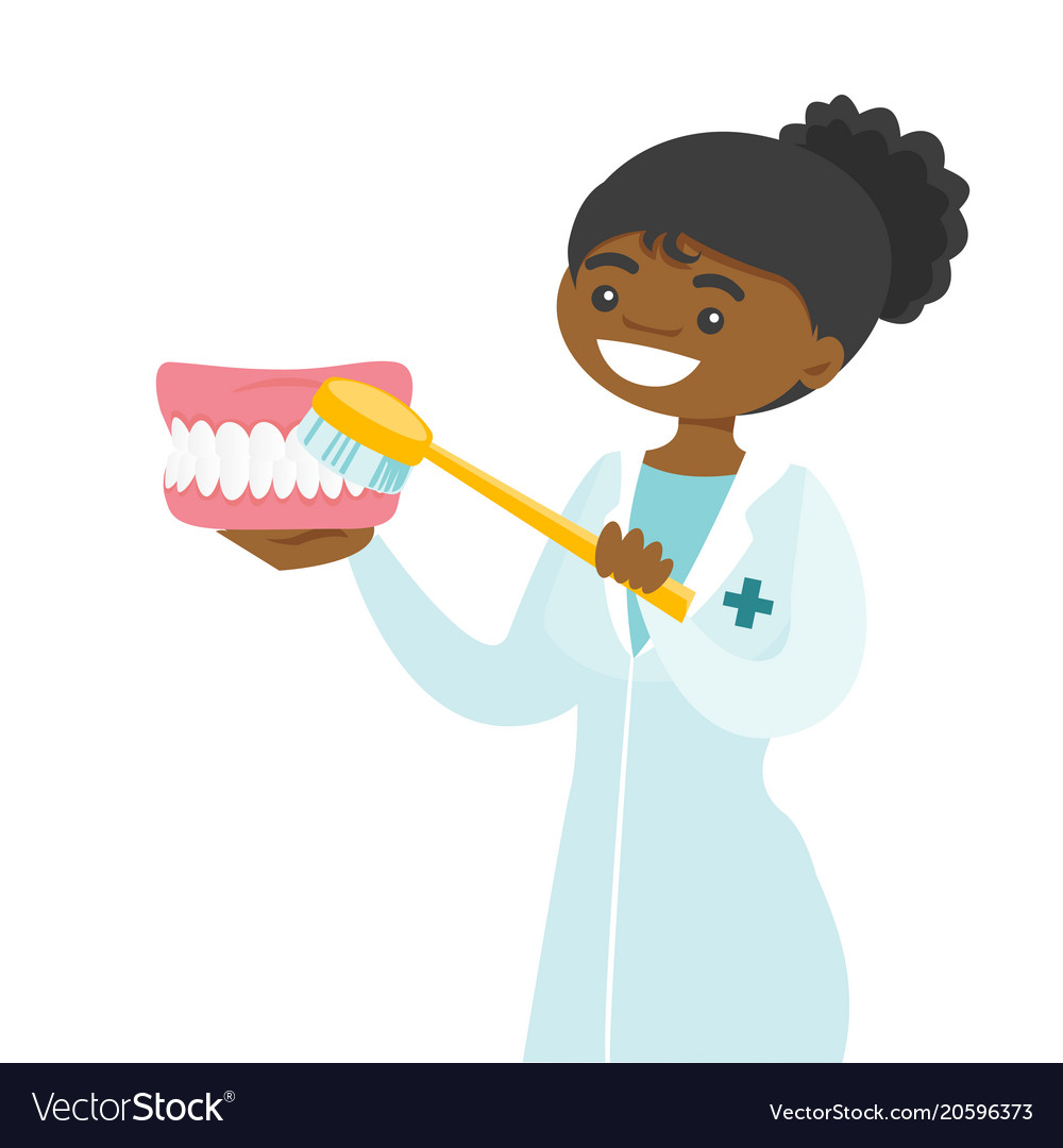 Young dentist cleaning jaw model with toothbrush