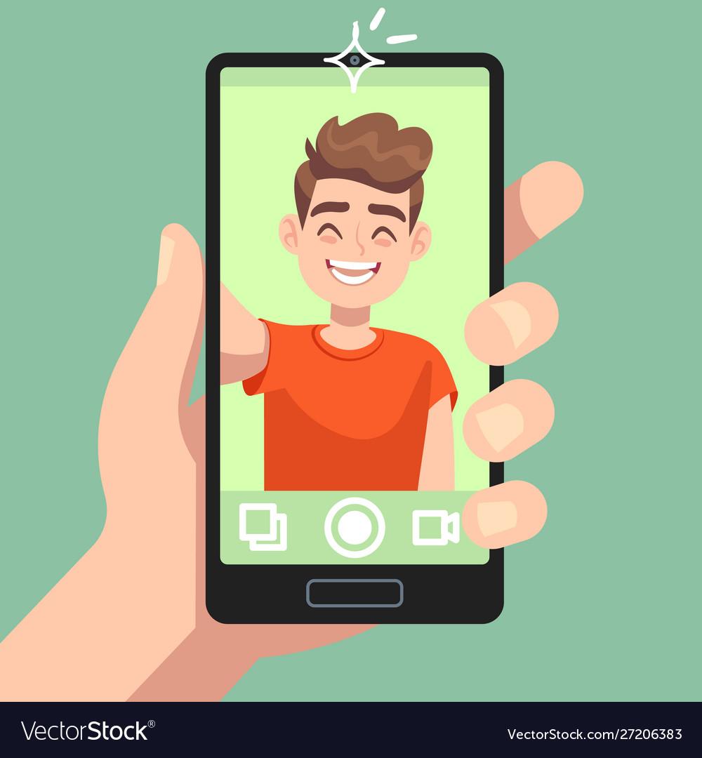 Man taking selfie photo on smartphone smiling