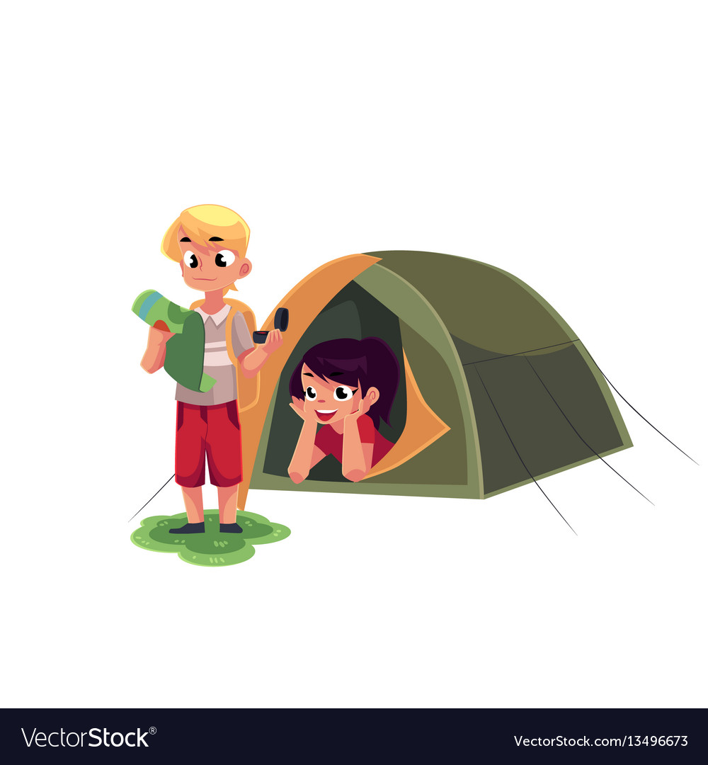 Boy studying map with compass and girl in camping