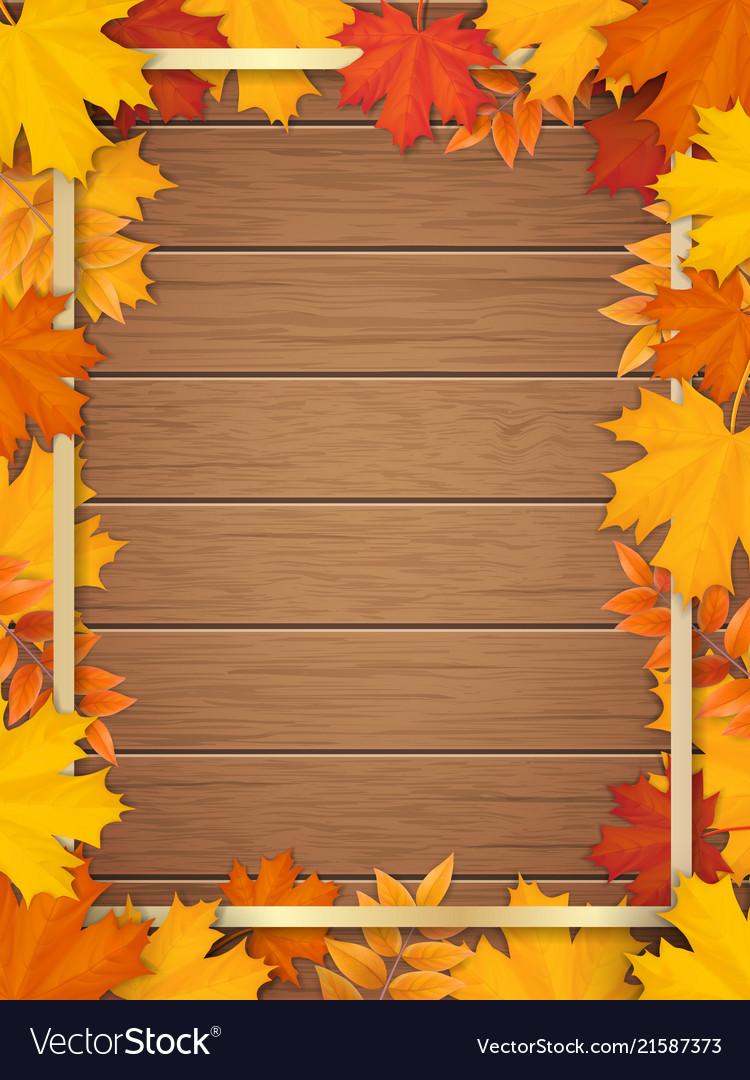 Autumn leaves golden frame wooden background