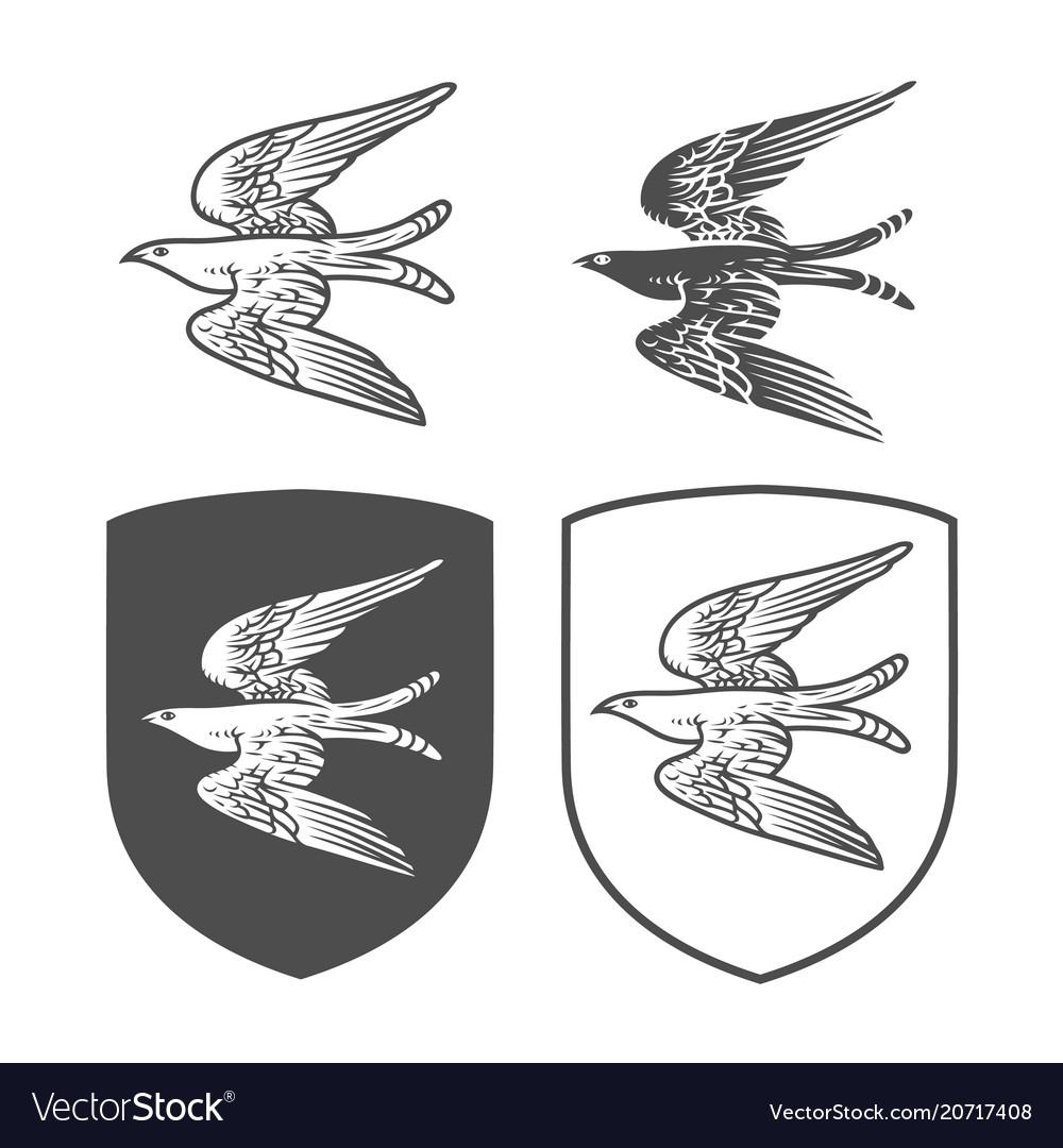 Heraldic shields with bird
