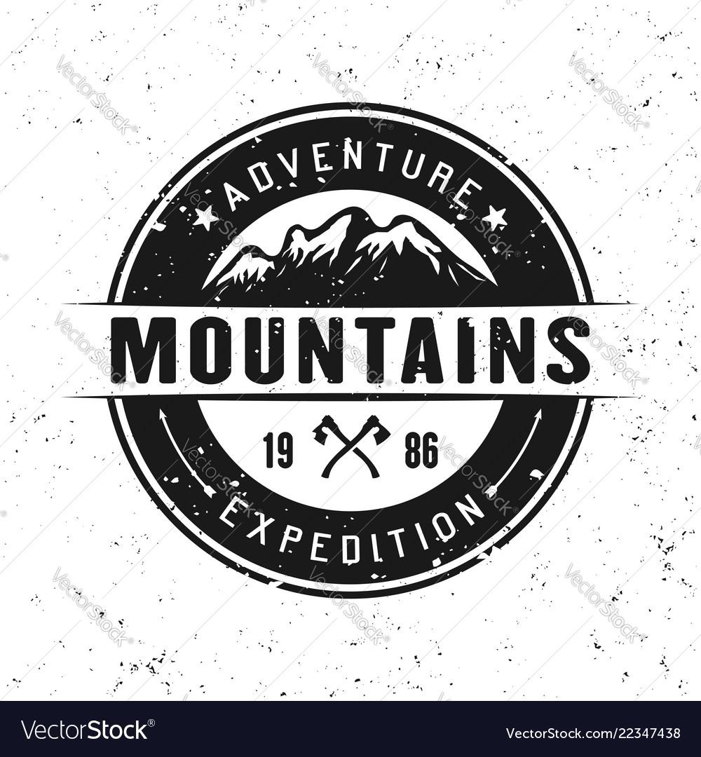 Mountains round badge isolated on white