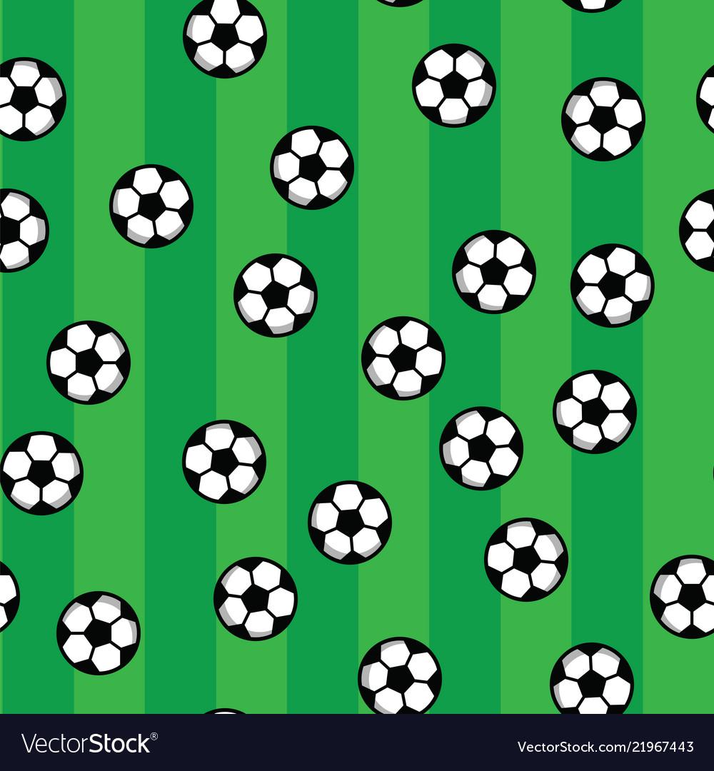 Soccer balls on green lawn of football field
