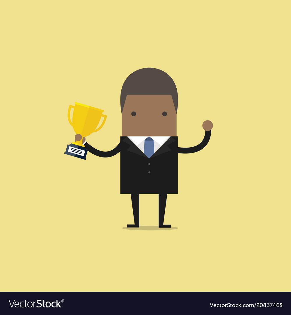 African businessman holding winning trophy