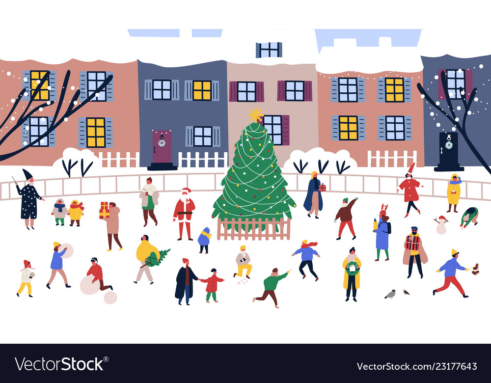 Men and women walking around big christmas tree