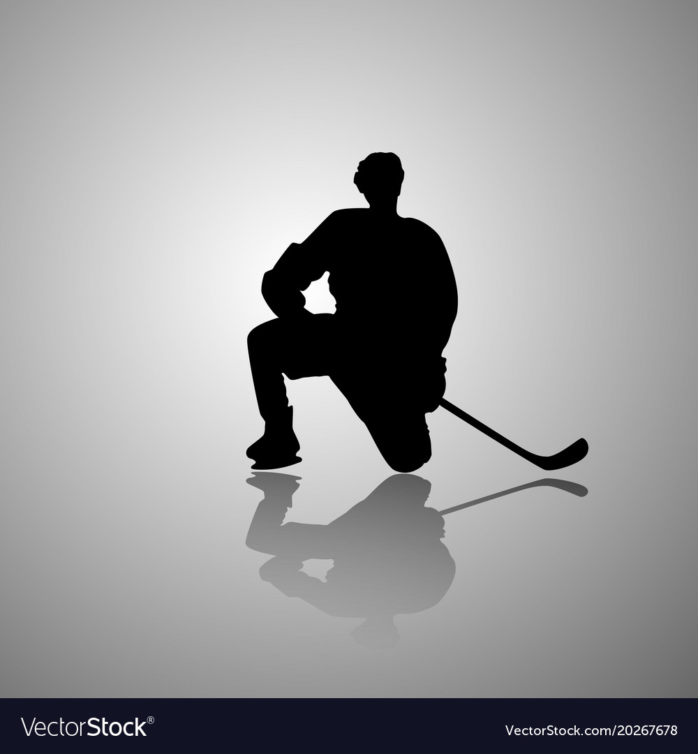 Image of a hockey player sitting on one knee with