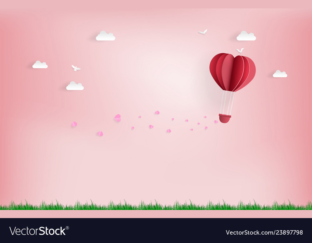 Balloon flying over cloud with pink heart float