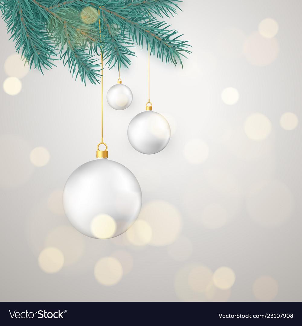 White christmas balls hanging on new year tree