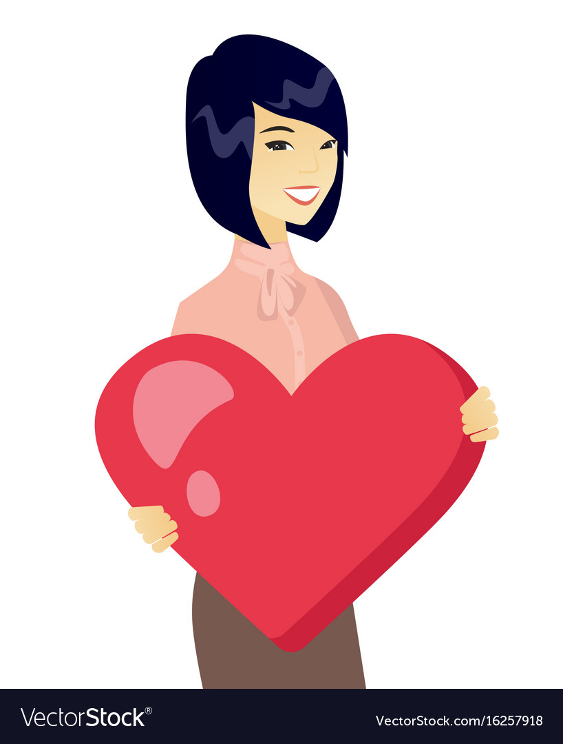 Young asian business woman holding a big heart