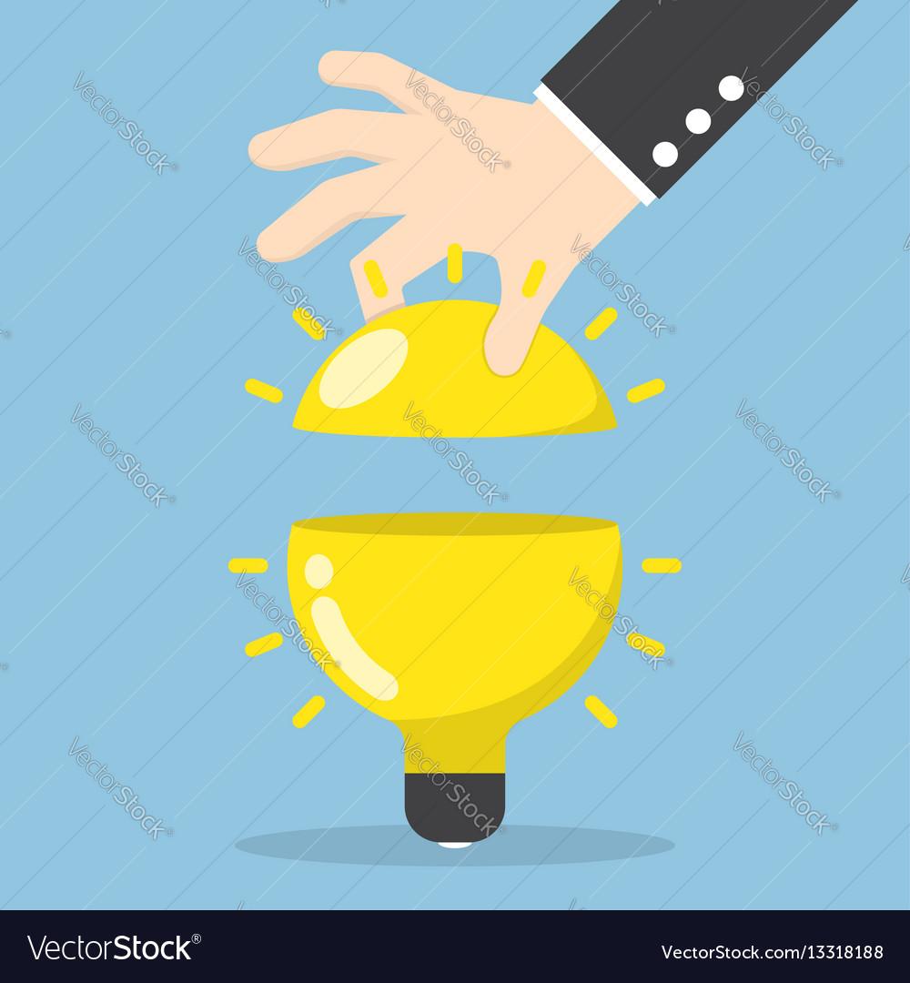Businessman hand open the light bulb