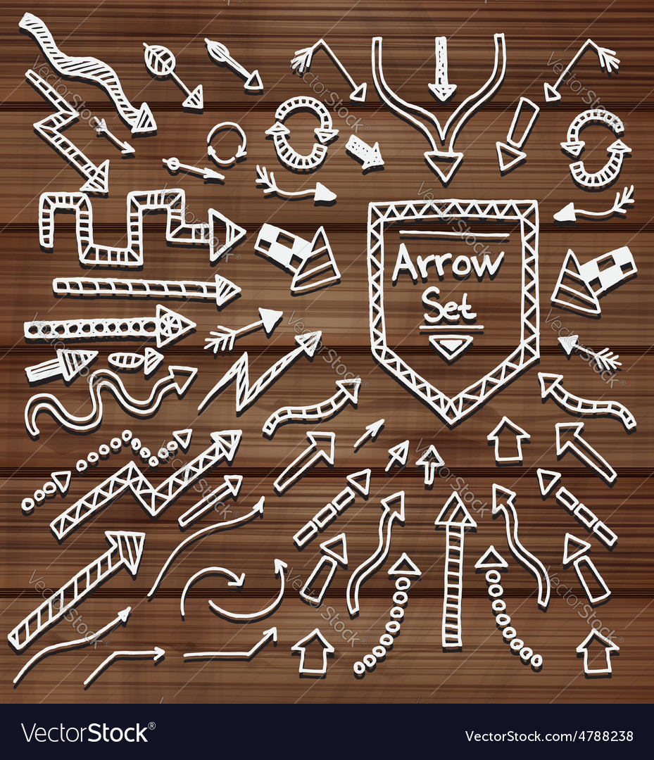 Hand drawn arrows on wooden texture