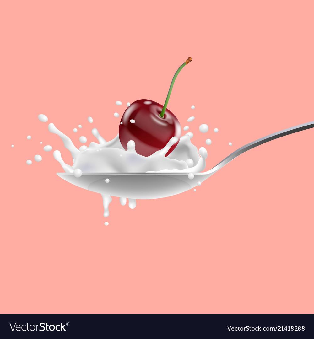 Red cherry and with milk splashing on spoon yogurt