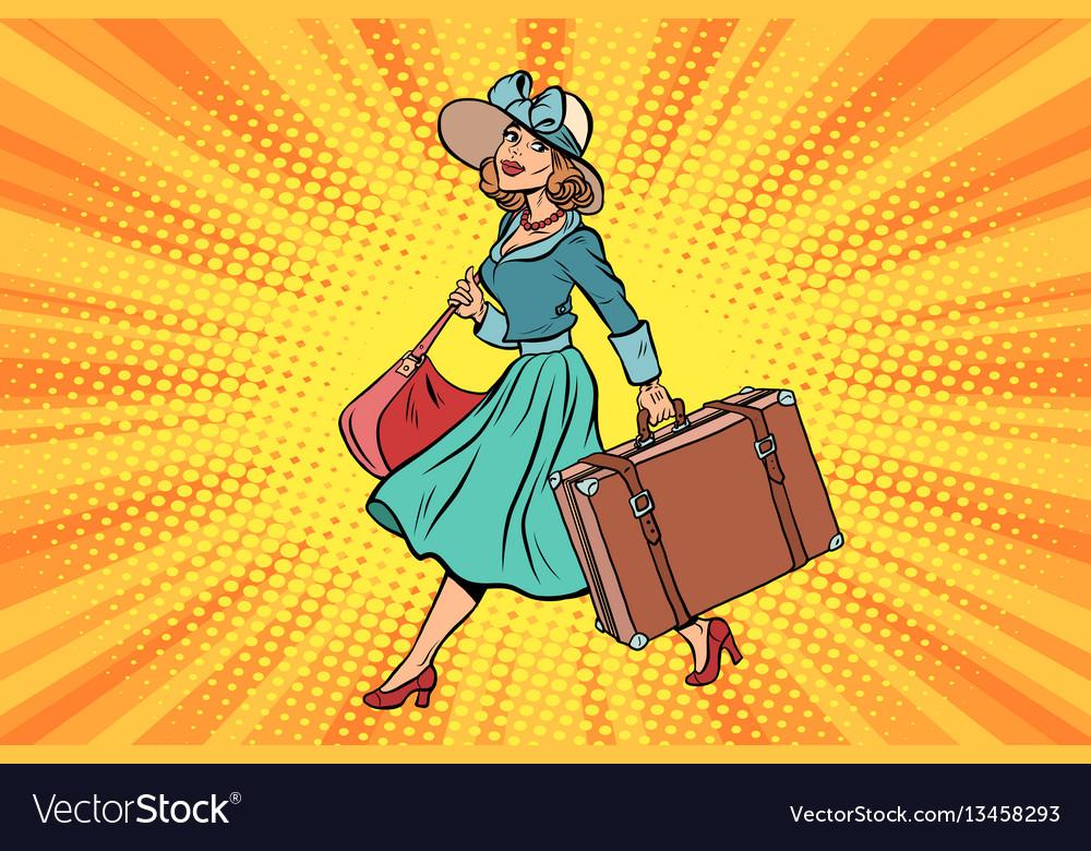 Retro traveler girl with a suitcase
