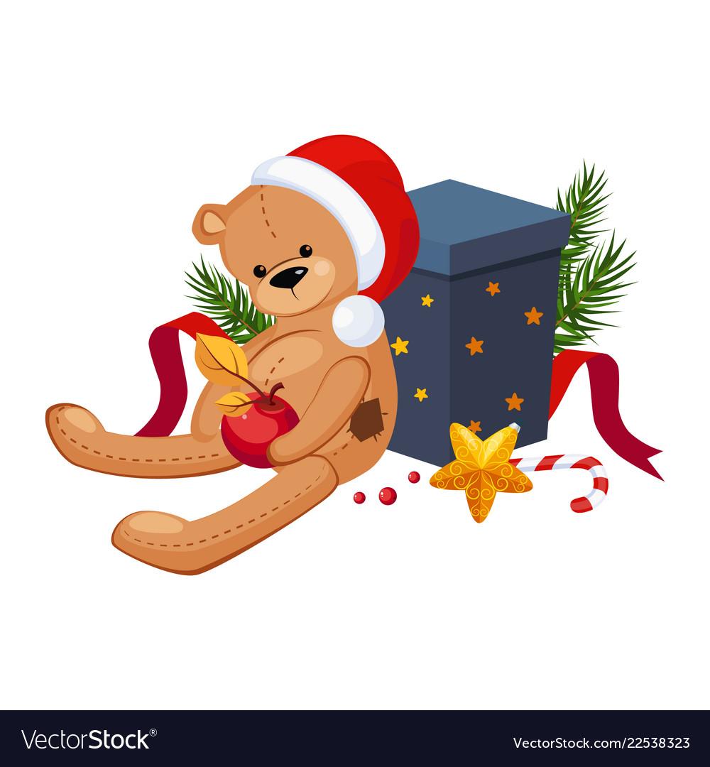 Cute teddy bear in a christmas hat sitting near